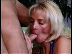 Naughty older blonde sexpot sucks off an assfucked bi guy