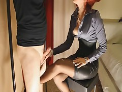 Woman In Classy Headmistress Style Outfits Gives Handjob