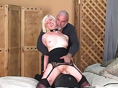Slave gets on dildo and mistress controls it and pulls her nipples